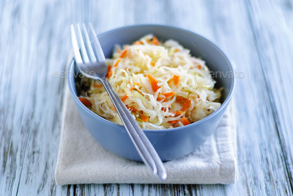 Bowl with sauerkraut standing on table - Stock Photo - Images
