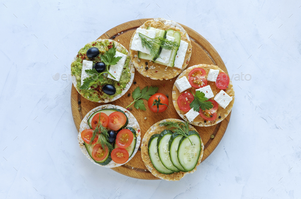 Homemade delicious appetizers on rice cakes - Stock Photo - Images