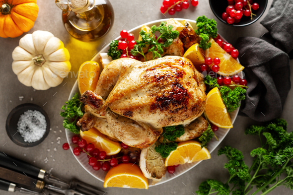 Whole baked chicken with vegetables - Stock Photo - Images