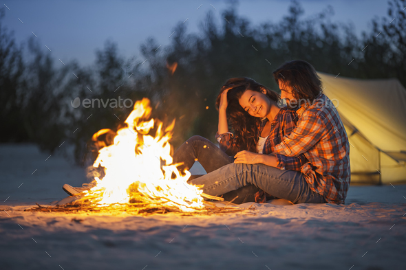 Couple Camping Near Campfire - Stock Photo - Images