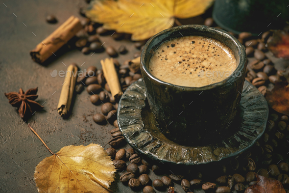 Black coffee with autumn leaves - Stock Photo - Images