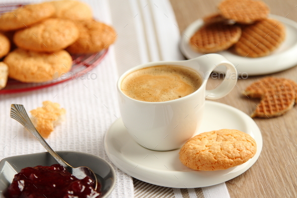 Cup of espresso with coconut cookies on a plate - Stock Photo - Images