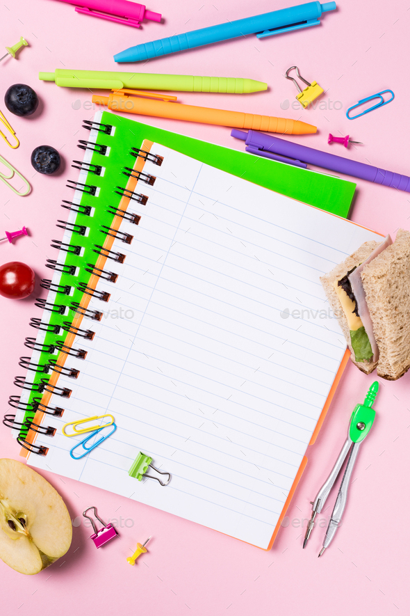 School background with notebooks and colorful supplies - Stock Photo - Images