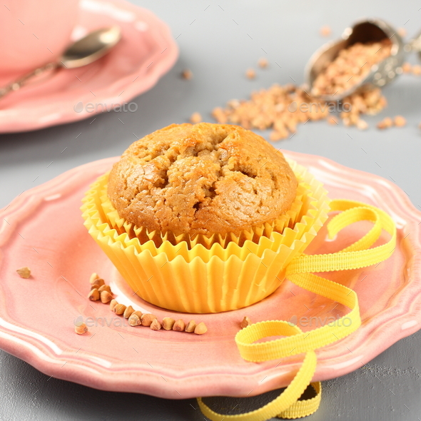 Freshly baked buckwheat muffins on the rose plate - Stock Photo - Images