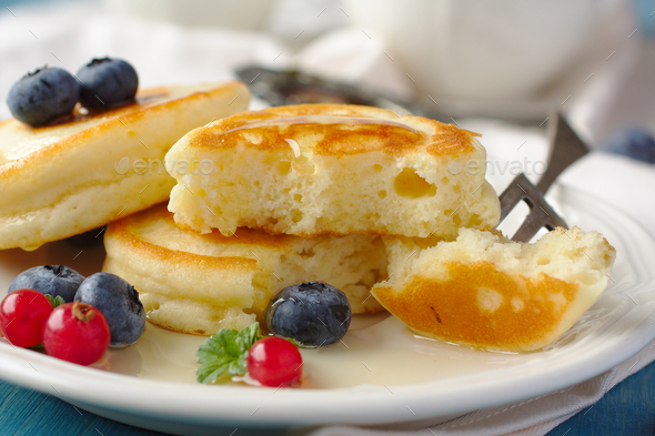 Homemade delicious pancakes with fresh berries and honey - Stock Photo - Images