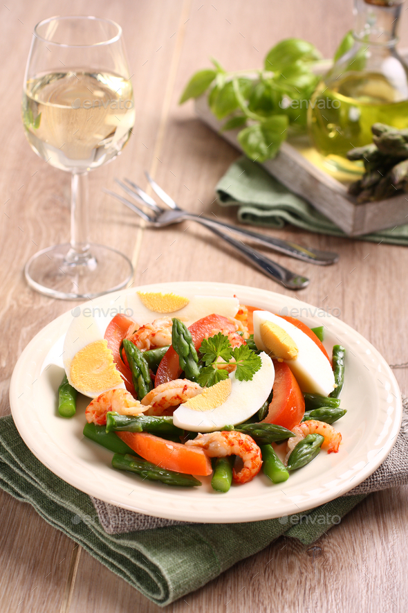 Fresh salad with asparagus, eggs, shrimp and tomatoes - Stock Photo - Images