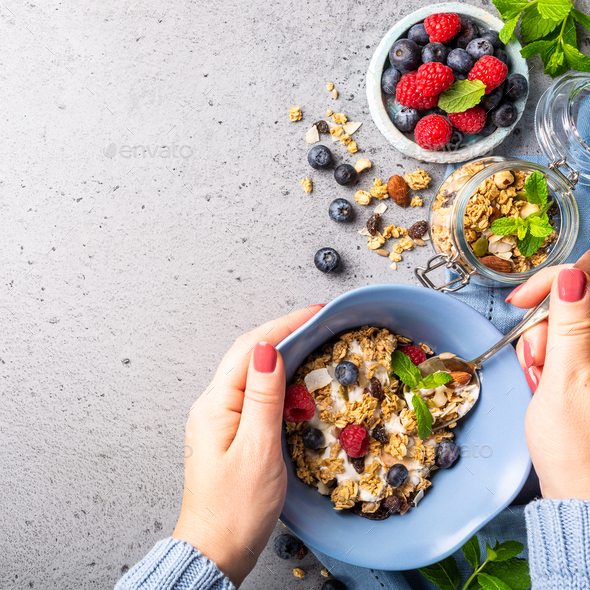 Oat granola with berries and yoghurt - Stock Photo - Images