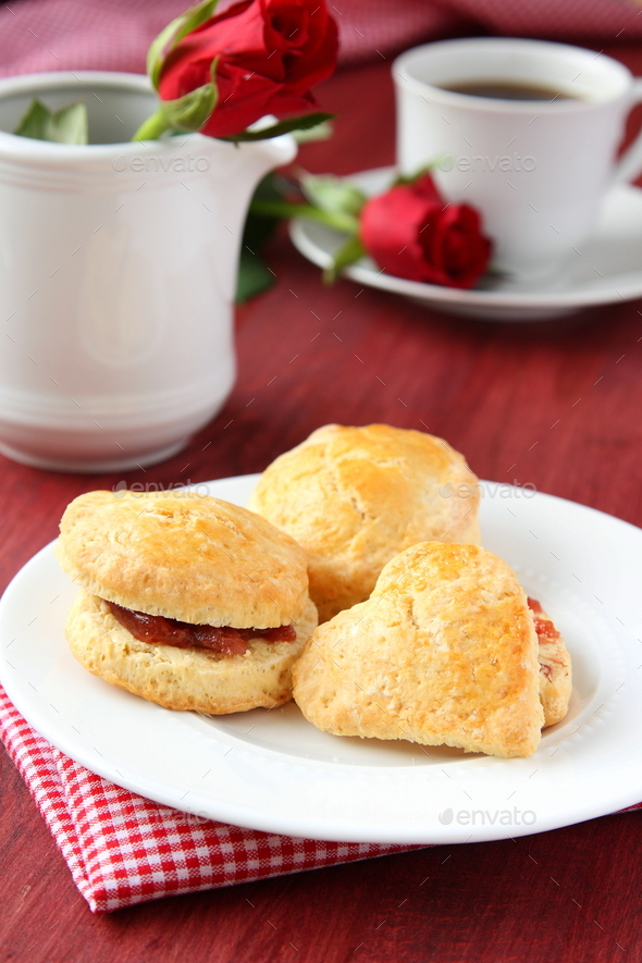 Home made scones with strawberry jam and a cup of tea - Stock Photo - Images