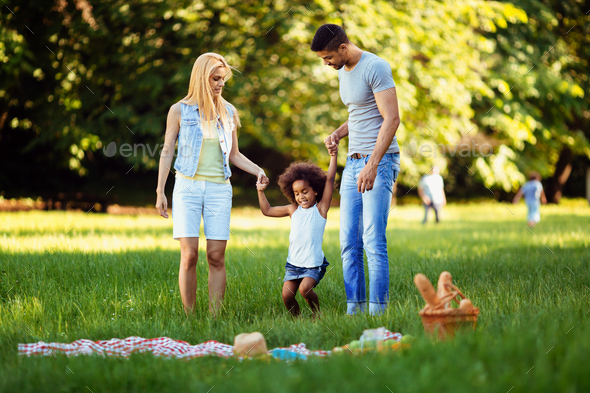 Happy young couple spending time with their daughter - Stock Photo - Images