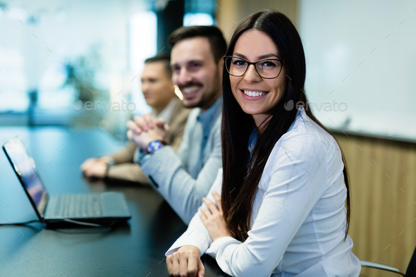 Portrait of young businesswoman in conference room - Stock Photo - Images