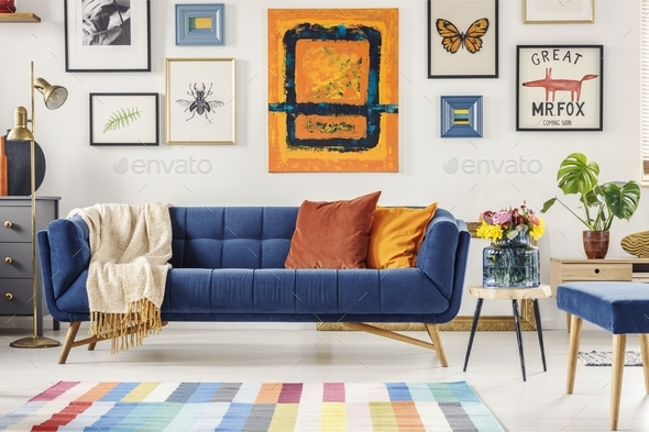 Painting Above Navy Blue Couch In Artistic Living Room Interior Stock Photo By Bialasiewicz