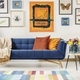 Painting above navy blue couch in artistic living room interior - PhotoDune Item for Sale