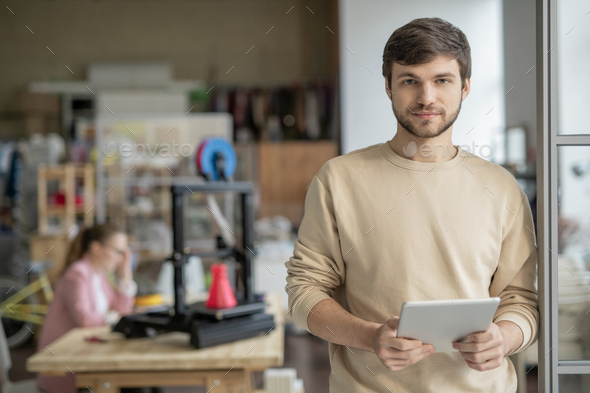 Young handsome businessman with tablet surfing in the net for creative websites - Stock Photo - Images