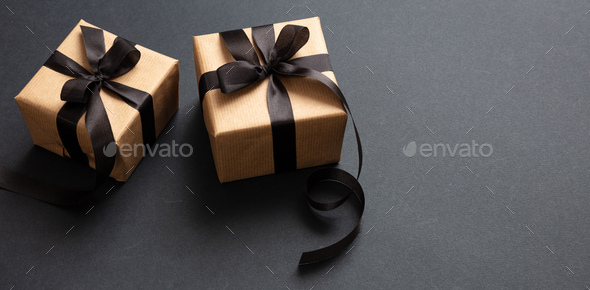 Gifts with black ribbon against black background, Black Friday concept. - Stock Photo - Images