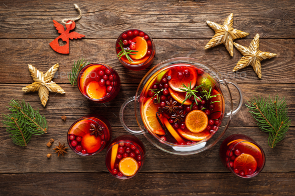 Christmas punch. Festive red hot toddy cocktail, drink with cranberries and citrus fruits - Stock Photo - Images