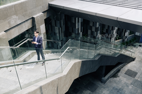 Lost man standing on stairs - Stock Photo - Images