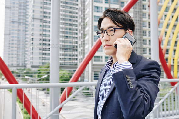Serious businessman calling on phone - Stock Photo - Images