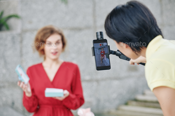 Woman shooting beauty blogger - Stock Photo - Images