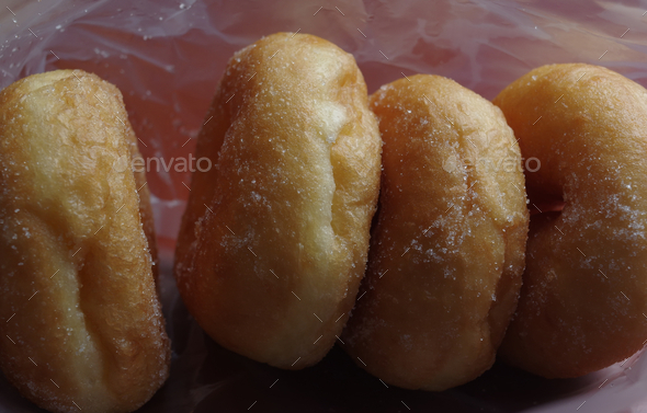 Close-up view doughnuts in a plastic bag - Stock Photo - Images