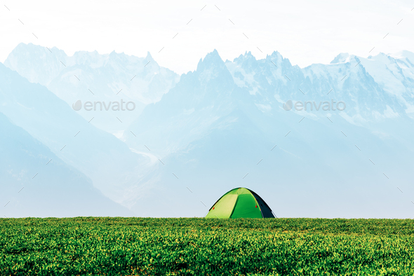 Green tent in spring mountains - Stock Photo - Images