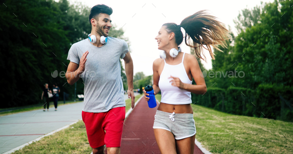 Couple jogging outdoors - Stock Photo - Images