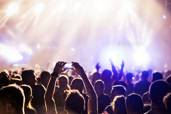 Picture of dancing crowd at music festival - Stock Photo - Images