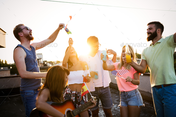 Happy group of young friends having fun in summer - Stock Photo - Images