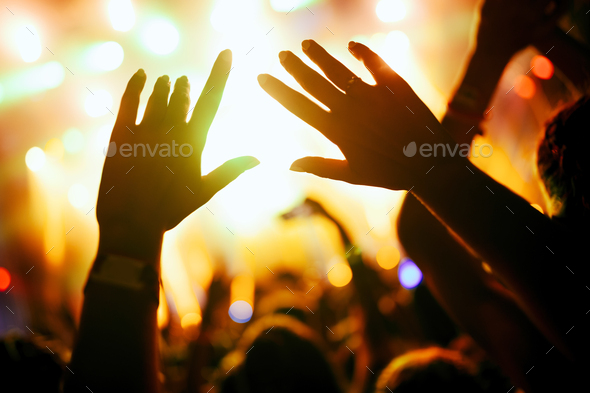 Portrait of happy crowd enjoying at music festival - Stock Photo - Images