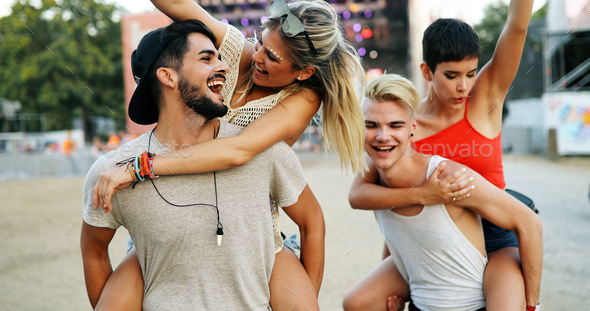 Happy young people having fun - Stock Photo - Images