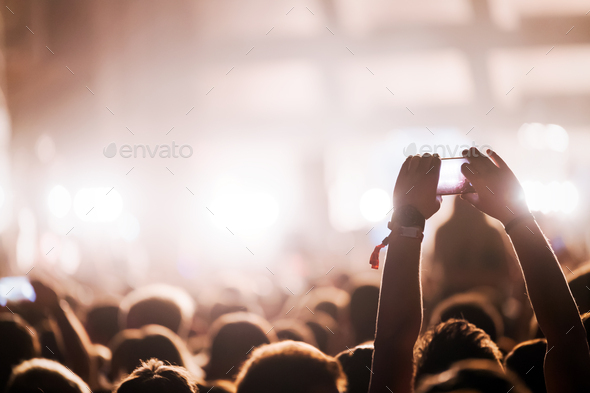 Picture of party people at music festival - Stock Photo - Images