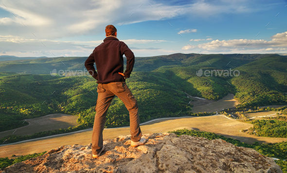 Man on top of mountain. - Stock Photo - Images