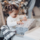 Lovely little girl unwrapping the present at Christmas - PhotoDune Item for Sale