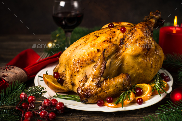Chrismas chicken baked with cranberry, orange and rosemary. Christmas dinner - Stock Photo - Images