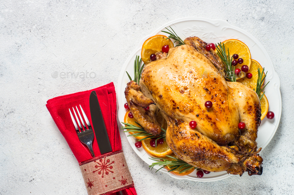 Chrismas chicken baked with cranberry, orange and rosemary. Christmas food - Stock Photo - Images