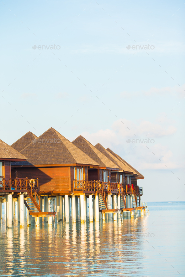Water bungalows with turquiose water on Maldives - Stock Photo - Images