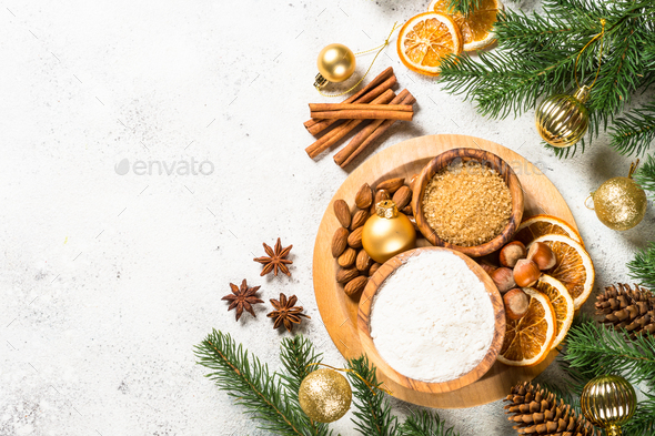 Christmas baking background with spices on white - Stock Photo - Images