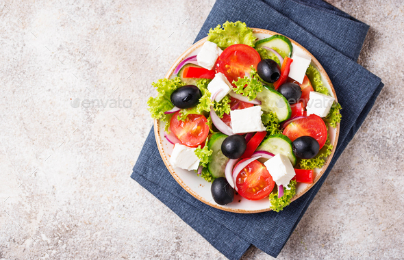 Traditional Greek salad with feta, olives and vegetables - Stock Photo - Images
