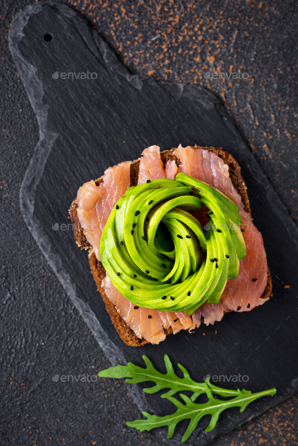 Healthy toasts with salmon and avocado rose - Stock Photo - Images