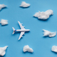 Flat lay design of travel concept with plane and cloud on blue background with copy space. - PhotoDune Item for Sale