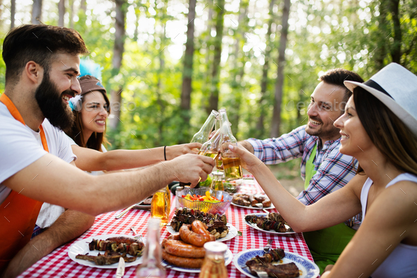Small group of friends having fun at barbecue party - Stock Photo - Images