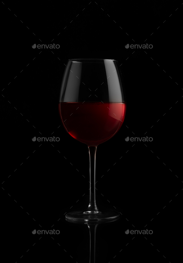 Red wine glass on a black background - Stock Photo - Images
