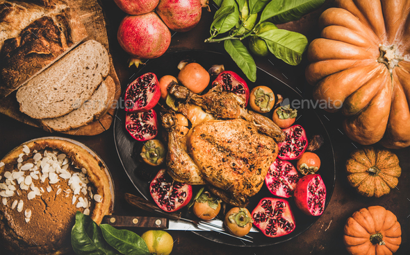 Thanksgiving table with roasted turkey and pumpkin pie, top view - Stock Photo - Images