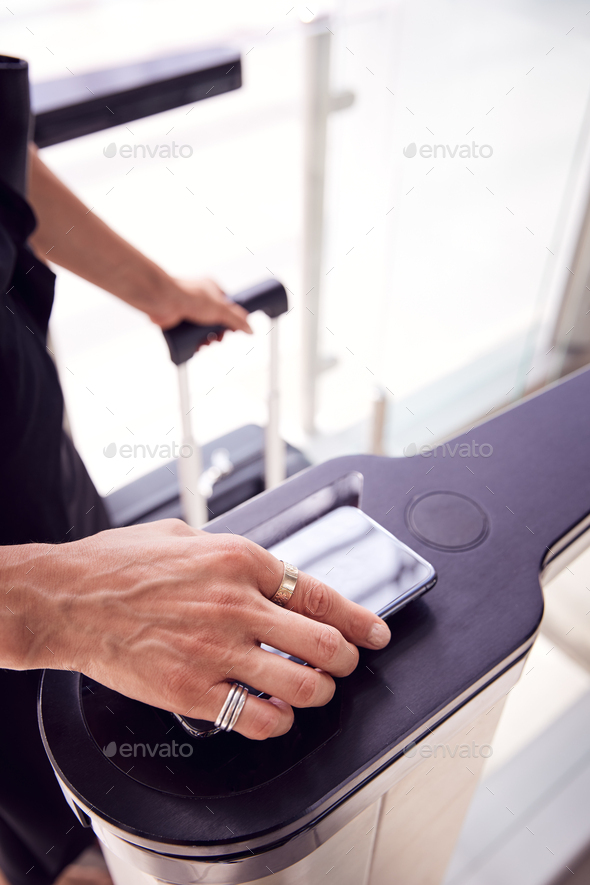 Close Up Of Passenger In Airport Departure Lounge Scanning Digital Boarding Pass On Smart Phone - Stock Photo - Images