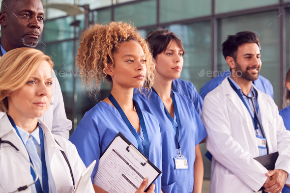 Serious Medical Team Standing In Modern Hospital Building - Stock Photo - Images