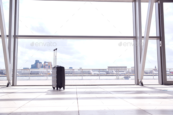 Unattended Suitcase Posing Security Threat In Airport Building - Stock Photo - Images