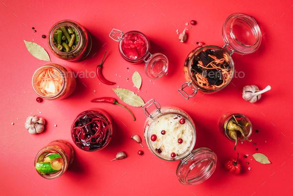 Probiotics food background. Korean carrot, kimchi, beetroot, sauerkraut, pickled cucumbers in glass - Stock Photo - Images