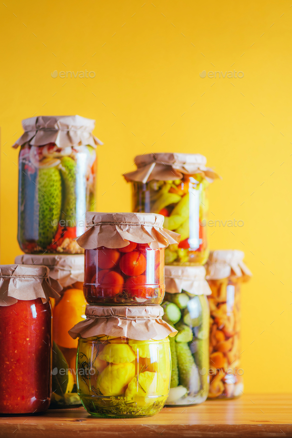 Preserved and fermented food in glass jars. Fermented food. Autumn canning. ?ucumber, squash and - Stock Photo - Images