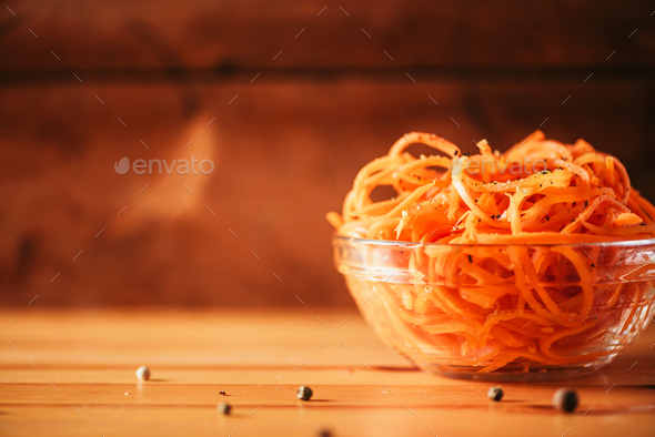 Spicy korean carrot salad on wooden background. Copy space. Koryo-saram cuisine - Stock Photo - Images