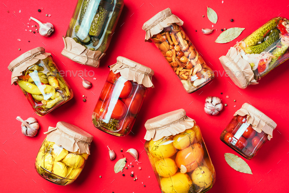 ?ucumber, squash and tomatoes pickling and canning into glass jars. Ingredients for vegetables - Stock Photo - Images