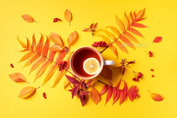 Autumn flat lay composition. Cup of tea, autumn bright leaves on yellow background. Top view. Flat - Stock Photo - Images